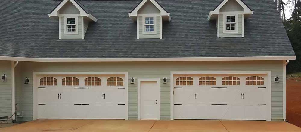 New Home Double Garage Doors and Opener Installation Service by Rolling Garage Doors & Gates